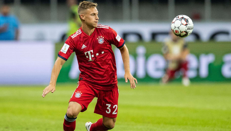 FRANKFURT AM MAIN, GERMANY - AUGUST 12: Joshua Kimmich of FC Bayern Muenchen runs with the ball during the DFL Supercup 2018 match between Eintracht Frankfurt and Bayern Muenchen at Commerzbank-Arena on August 12, 2018 in Frankfurt am Main, Germany.  (Photo by Boris Streubel/Getty Images)