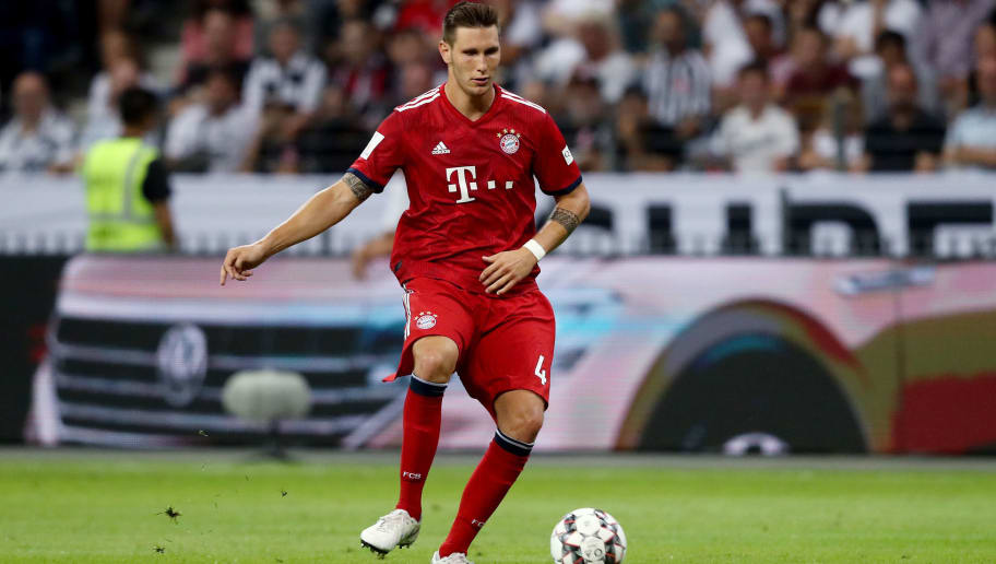 FRANKFURT AM MAIN, GERMANY - AUGUST 12: Niklas Suele of Bayern runs with the ball during the DFL Supercup match between Eintracht Frankfurt an Bayern Muenchen at Commerzbank-Arena on August 12, 2018 in Frankfurt am Main, Germany. (Photo by Christof Koepsel/Bongarts/Getty Images)