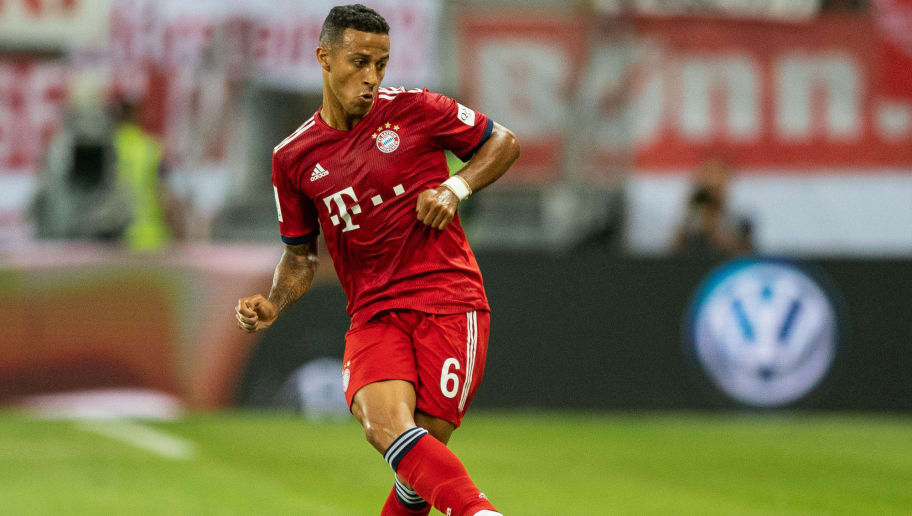 FRANKFURT AM MAIN, GERMANY - AUGUST 12: Thiago Alcantara of FC Bayern Muenchen runs with the ball during the DFL Supercup 2018 match between Eintracht Frankfurt and Bayern Muenchen at Commerzbank-Arena on August 12, 2018 in Frankfurt am Main, Germany.  (Photo by Boris Streubel/Getty Images)