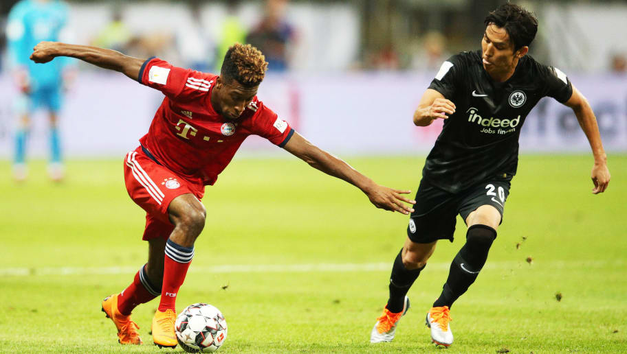 FRANKFURT AM MAIN, GERMANY - AUGUST 12:  Kingsley Coman of Bayern Munich controls the ball in front of Makoto Hasebe of Eintracht Frankfurt during the DFL Supercup 2018 match between Eintracht Frankfurt and Bayern Muenchen at Commerzbank-Arena on August 12, 2018 in Frankfurt am Main, Germany.  (Photo by Adam Pretty/Bongarts/Getty Images)