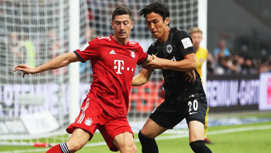 FRANKFURT AM MAIN, GERMANY - AUGUST 12:  Robert Lewandowski of Bayern Munich is challenged by Makoto Hasebe of Eintracht Frankfurt during the DFL Supercup 2018 match between Eintracht Frankfurt and Bayern Muenchen at Commerzbank-Arena on August 12, 2018 in Frankfurt am Main, Germany.  (Photo by Adam Pretty/Bongarts/Getty Images)