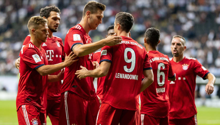 FRANKFURT AM MAIN, GERMANY - AUGUST 12: Robert Lewandowski of FC Bayern Muenchen celebrates with team mates after scoring his team's third goal during the DFL Supercup 2018 match between Eintracht Frankfurt and Bayern Muenchen at Commerzbank-Arena on August 12, 2018 in Frankfurt am Main, Germany.  (Photo by Boris Streubel/Getty Images)