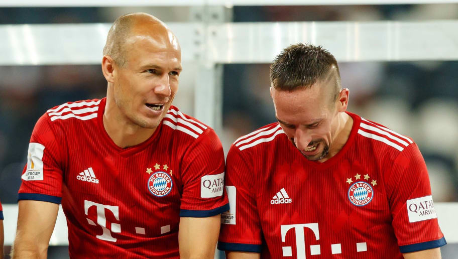 FRANKFURT AM MAIN, GERMANY - AUGUST 12: Arjen Robben of Bayern Muenchen speaks with Franck Ribery of Bayern Muenchen prior to the DFL Supercup match between Eintracht Frankfurt and Bayern Muenchen at Commerzbank-Arena on August 12, 2018 in Frankfurt am Main, Germany. (Photo by TF-Images/Getty Images)