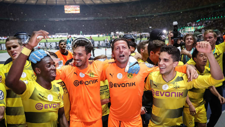 BERLIN, GERMANY - MAY 27: Ousmane Dembele of Dortmund (L-R), Roman Buerki, Roman Weidenfeller and Marc Bartra celebrate after winning the DFB Cup final match between Eintracht Frankfurt and Borussia Dortmund at Olympiastadion on May 27, 2017 in Berlin, Germany. (Photo by Maja Hitij/Bongarts/Getty Images)