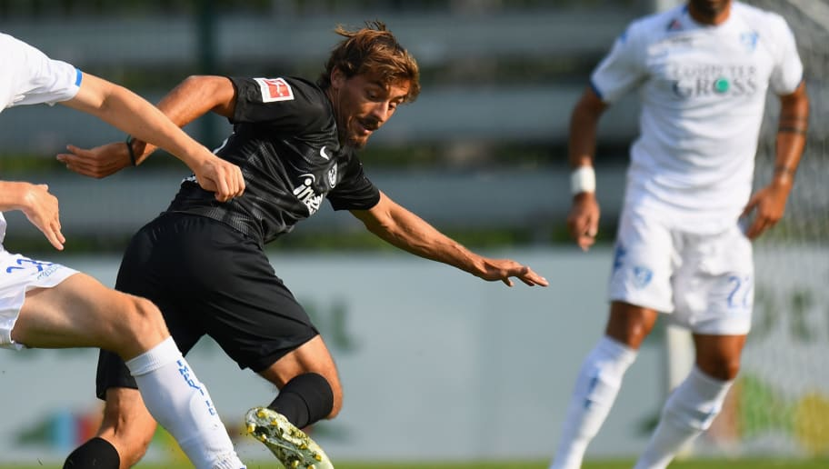 BRUNECK, ITALY - AUGUST 01: Jabok Rasmussen of Empoli Fc competes for the ball with Chico Geraldes of Eintracht Frankfurt during the pre-season friendly match between Eintracht Frankfurt and Empoli FC on August 1, 2018 in Bruneck, Italy.  (Photo by Alessandro Sabattini/Getty Images)