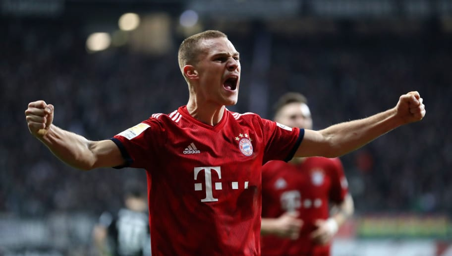 FRANKFURT AM MAIN, GERMANY - DECEMBER 22:  Joshua Kimmich of Bayern Munich celebrates after his team's third goal during the Bundesliga match between Eintracht Frankfurt and FC Bayern Muenchen at Commerzbank-Arena on December 22, 2018 in Frankfurt am Main, Germany.  (Photo by Simon Hofmann/Bongarts/Getty Images)