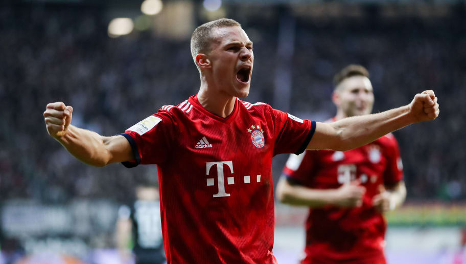 FRANKFURT AM MAIN, GERMANY - DECEMBER 22: Joshua Kimmich of Muenchen celebrates his team's third goal during the Bundesliga match between Eintracht Frankfurt and FC Bayern Muenchen at Commerzbank-Arena on December 22, 2018 in Frankfurt am Main, Germany. (Photo by Simon Hofmann/Bongarts/Getty Images)