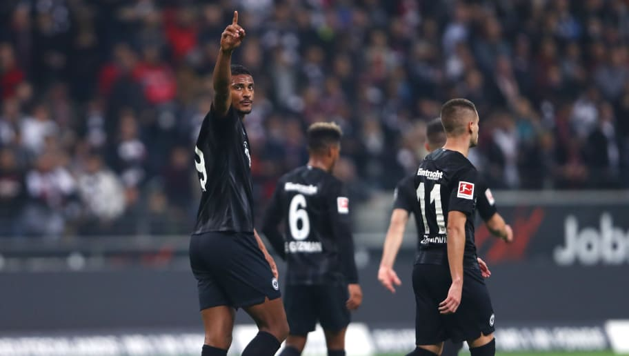 FRANKFURT AM MAIN, GERMANY - OCTOBER 19:  Sebastien Haller of Eintracht Frankfurt (L) celebrates with team mates as he scores his team's first goal from a penalty during the Bundesliga match between Eintracht Frankfurt and Fortuna Duesseldorf at Commerzbank-Arena on October 19, 2018 in Frankfurt am Main, Germany.  (Photo by Alex Grimm/Bongarts/Getty Images)