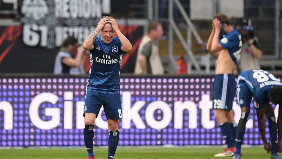 FRANKFURT AM MAIN, GERMANY - MAY 05: Lewis Holtby of Hamburg (8) looks dejected after Omar Mascarell of Frankfurt (not seen) scored a goal to make it 2:0 during the Bundesliga match between Eintracht Frankfurt and Hamburger SV at Commerzbank-Arena on May 5, 2018 in Frankfurt am Main, Germany. (Photo by Matthias Hangst/Bongarts/Getty Images)