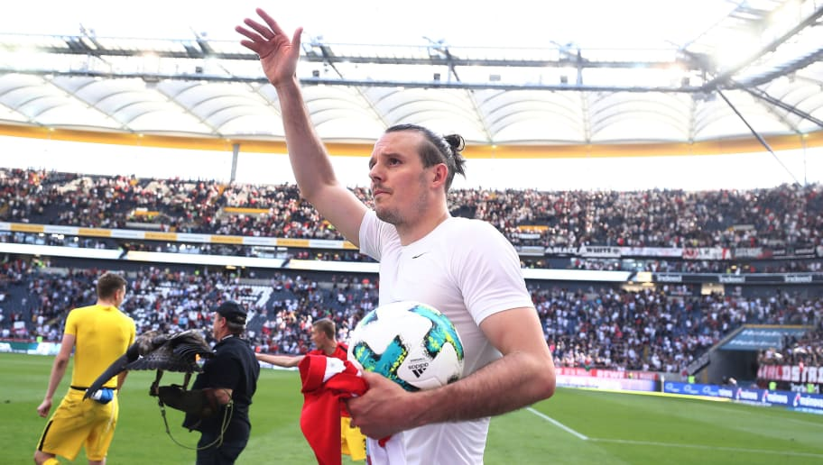 FRANKFURT AM MAIN, GERMANY - MAY 05: Alexander Meier of Frankfurt celebrate celebrates with a match ball in hand, after the Bundesliga match between Eintracht Frankfurt and Hamburger SV at Commerzbank-Arena on May 5, 2018 in Frankfurt am Main, Germany. (Photo by Alex Grimm/Bongarts/Getty Images)