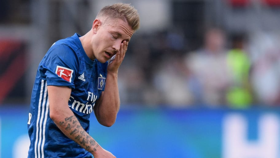 FRANKFURT AM MAIN, GERMANY - MAY 05: Lewis Holtby of Hamburg shows his disappointment during the Bundesliga match between Eintracht Frankfurt and Hamburger SV at Commerzbank-Arena on May 5, 2018 in Frankfurt am Main, Germany. (Photo by Matthias Hangst/Bongarts/Getty Images)