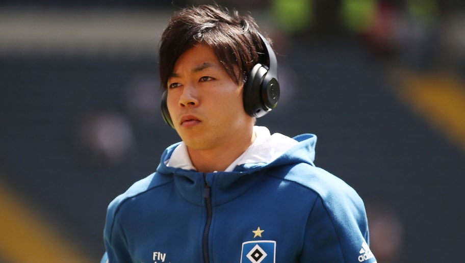FRANKFURT AM MAIN, GERMANY - MAY 05: Tatsuya Ito of Hamburg with headset looks on before the Bundesliga match between Eintracht Frankfurt and Hamburger SV at Commerzbank-Arena on May 5, 2018 in Frankfurt am Main, Germany. (Photo by Alex Grimm/Bongarts/Getty Images)