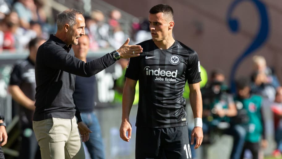 FRANKFURT AM MAIN, GERMANY - SEPTEMBER 30: Manager Adi Huetter of Frankfurt (L) gives instructions to Filip Kostic during the Bundesliga match between Eintracht Frankfurt and Hannover 96 at Commerzbank-Arena on September 30, 2018 in Frankfurt am Main, Germany. (Photo by Juergen Schwarz/Bongarts/Getty Images)