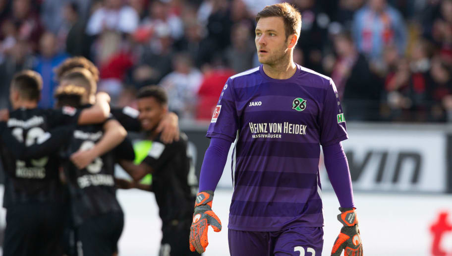 FRANKFURT AM MAIN, GERMANY - SEPTEMBER 30: Goalkeeper Michael Esser of Hannover looks on after frankfurt scored during the Bundesliga match between Eintracht Frankfurt and Hannover 96 at Commerzbank-Arena on September 30, 2018 in Frankfurt am Main, Germany. (Photo by Juergen Schwarz/Bongarts/Getty Images)