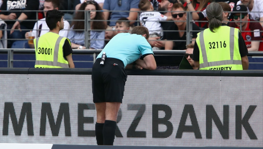 FRANKFURT AM MAIN, GERMANY - APRIL 21:  Referee Sascha Stegemann checks the VAR screen before confirming a penalty decision during the Bundesliga match between Eintracht Frankfurt and Hertha BSC at Commerzbank-Arena on April 21, 2018 in Frankfurt am Main, Germany.  (Photo by Alex Grimm/Bongarts/Getty Images)