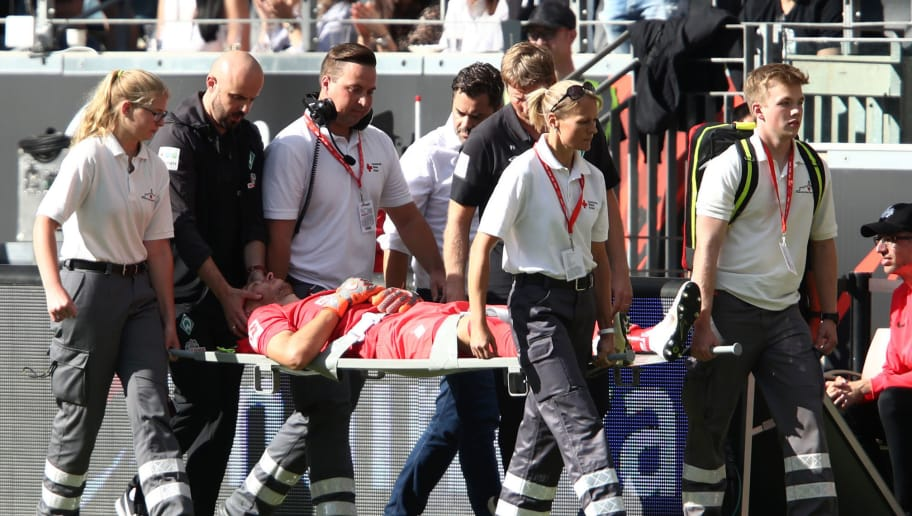 FRANKFURT AM MAIN, GERMANY - SEPTEMBER 01:  Jiri Pavlenka of Werder Bremen is stretchered off injured during the Bundesliga match between Eintracht Frankfurt and SV Werder Bremen at Commerzbank-Arena on September 1, 2018 in Frankfurt am Main, Germany.  (Photo by Alex Grimm/Bongarts/Getty Images)