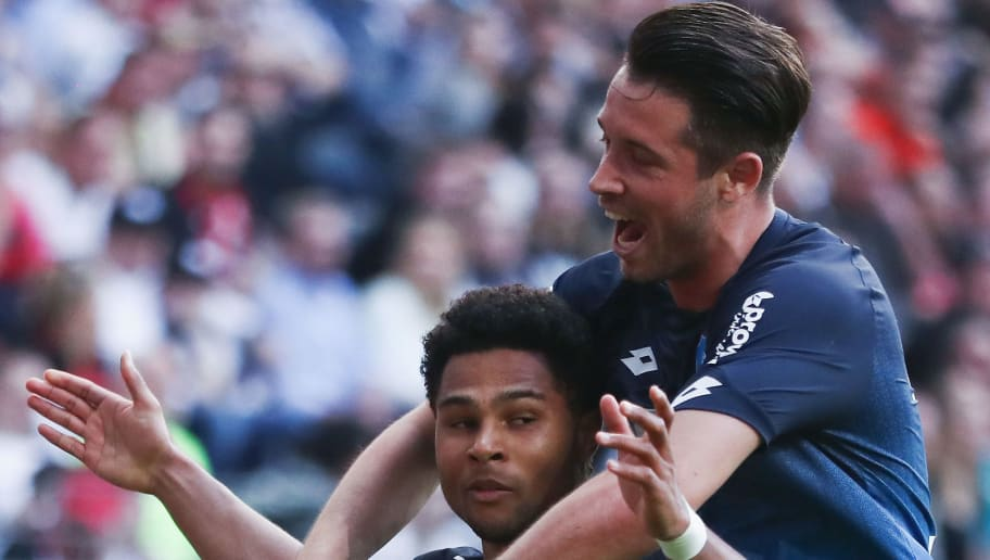 FRANKFURT AM MAIN, GERMANY - APRIL 08:  Serge Gnabry of Hoffenheim celebrates his team's first goal with team mate Mark Uth during the Bundesliga match between Eintracht Frankfurt and TSG 1899 Hoffenheim at Commerzbank-Arena on April 8, 2018 in Frankfurt am Main, Germany.  (Photo by Alex Grimm/Bongarts/Getty Images)