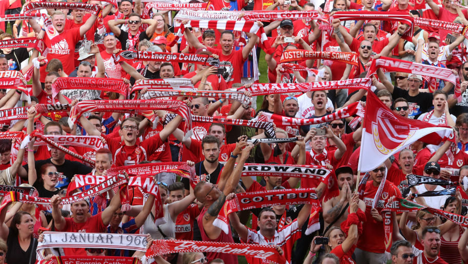 COTTBUS, GERMANY - MAY 27:  Supporters of Cottbus celebrate after their team moving up into the third league after the Third League Playoff Leg 2 match between FC Energie Cottbus and SC Weiche Flensburg 08 at Stadion der Freundschaft on May 27, 2018 in Cottbus, Germany.  (Photo by Matthias Kern/Bongarts/Getty Images)