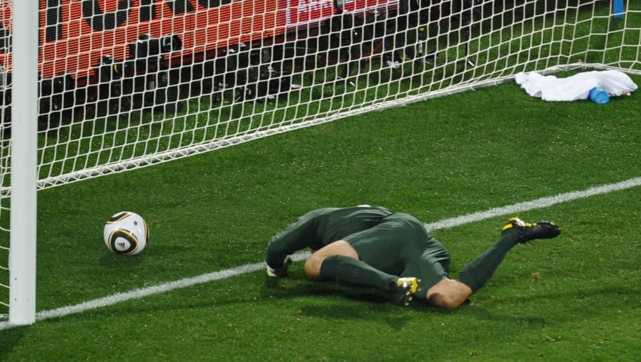 England's goalkeeper Robert Green misses the ball during the Group C first round 2010 World Cup football match England vs. USA on June 12, 2010 at Royal Bafokeng stadium in Rustenburg. NO PUSH TO MOBILE / MOBILE USE SOLELY WITHIN EDITORIAL ARTICLE -     AFP PHOTO / HOANG DINH NAM (Photo credit should read HOANG DINH NAM/AFP/Getty Images)