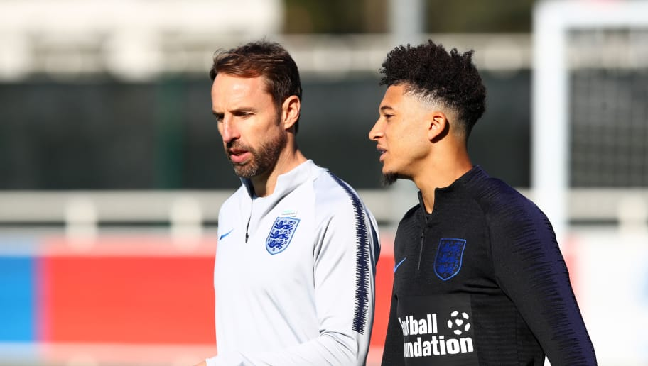 BURTON-UPON-TRENT, ENGLAND - OCTOBER 09:  Jadon Sancho speaks to Gareth Southgate during an England Training Session at St Georges Park on October 9, 2018 in Burton-upon-Trent, England.  (Photo by Clive Brunskill/Getty Images)
