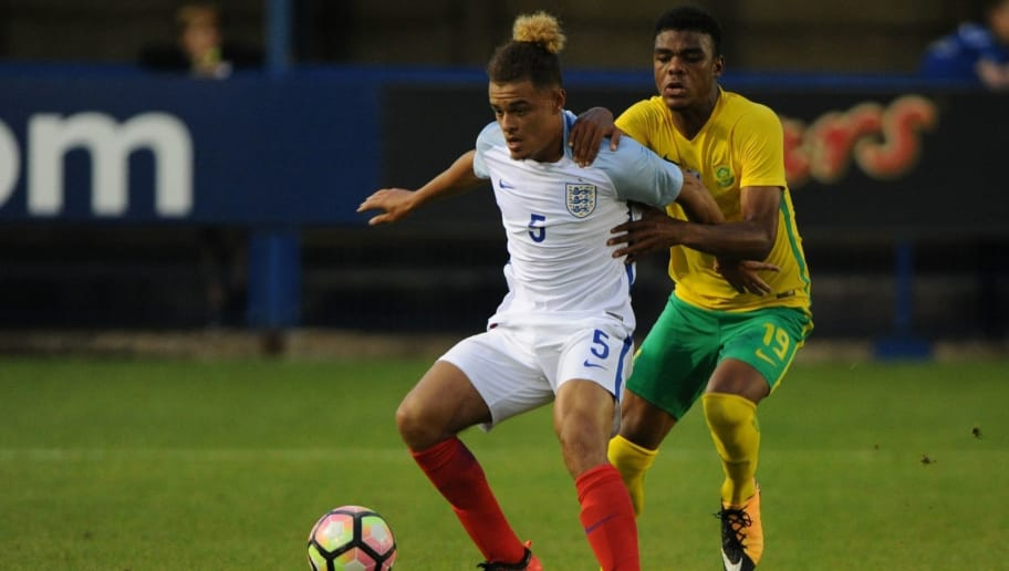 LEEK, ENGLAND - SEPTEMBER 04: Joel Latibeaudiere of England and Lyle Foster of South Africa in action during the international friendly match between England U18 and South Africa U18 on September 4, 2017 in Leek, England. (Photo by Nathan Stirk/Getty Images)