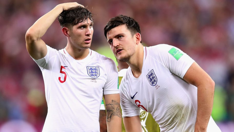 MOSCOW, RUSSIA - JULY 11:  John Stones and Harry Maguire both of England look dejected after the 2018 FIFA World Cup Russia Semi Final match between England and Croatia at Luzhniki Stadium on July 11, 2018 in Moscow, Russia.  (Photo by Chris Brunskill/Fantasista/Getty Images)