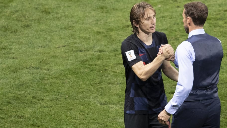 MOSCOW, RUSSIA - JULY 11:  England's coach Gareth Southgate congratulates Croatia's midfielder Luka Modric after Croatia won the Russia 2018 World Cup semi-final football match between Croatia and England at the Luzhniki Stadium in Moscow on July 11, 2018.  (Photo by Fred Lee/Getty Images)