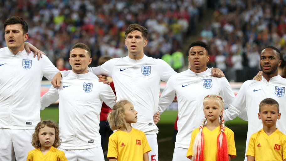 MOSCOW, RUSSIA - JULY 11:  Harry Maguire, Kieran Trippier, John Stones, Jesse Lingard and Raheem Sterling of England sing the national anthem prior to  the 2018 FIFA World Cup Russia Semi Final match between England and Croatia at Luzhniki Stadium on July 11, 2018 in Moscow, Russia.  (Photo by Clive Rose/Getty Images)