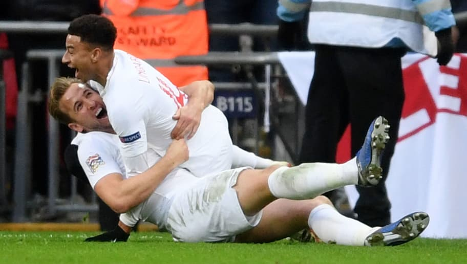 LONDON, ENGLAND - NOVEMBER 18:  Harry Kane of England celebrates with teammate Jesse Lingard after scoring his team's second goal during the UEFA Nations League A group four match between England and Croatia at Wembley Stadium on November 18, 2018 in London, United Kingdom.  (Photo by Laurence Griffiths/Getty Images)