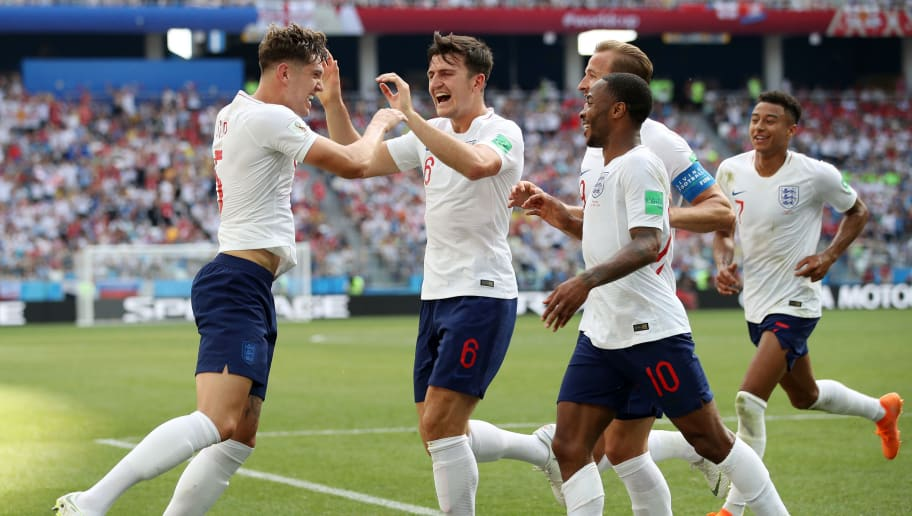 NIZHNY NOVGOROD, RUSSIA - JUNE 24:  John Stones of England celebrates with teammates after scoring his team's fourth goal during the 2018 FIFA World Cup Russia group G match between England and Panama at Nizhny Novgorod Stadium on June 24, 2018 in Nizhny Novgorod, Russia.  (Photo by Clive Brunskill/Getty Images)