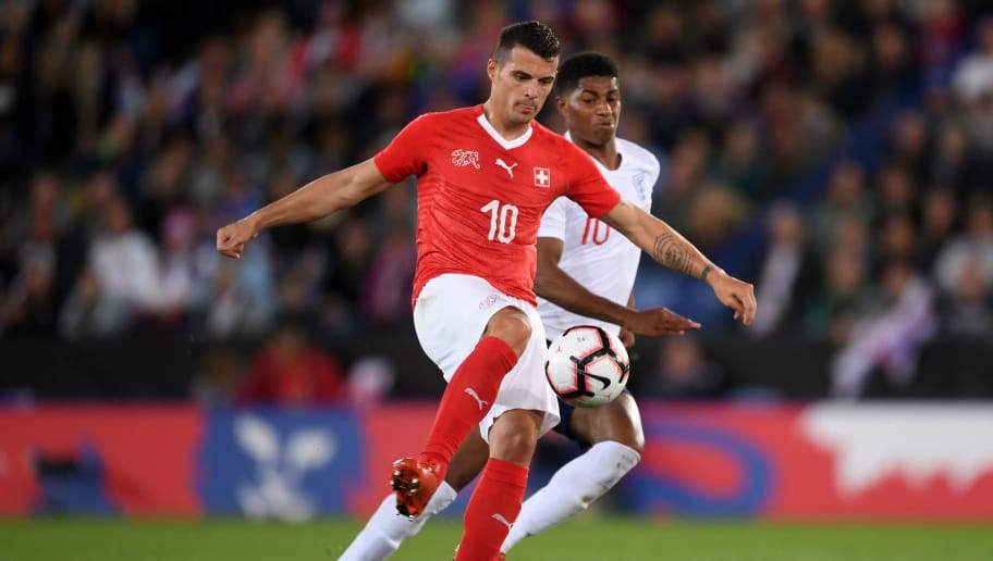 LEICESTER, ENGLAND - SEPTEMBER 11:  Granit Xhaka of Switzerland holds off Marcus Rashford of England during the international friendly match between England and Switzerland at The King Power Stadium on September 11, 2018 in Leicester, United Kingdom.  (Photo by Laurence Griffiths/Getty Images)