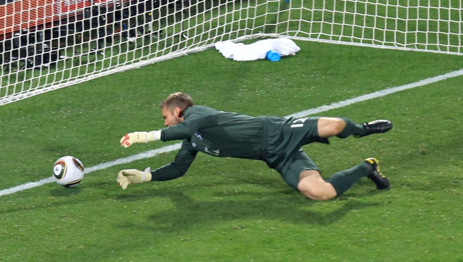 RUSTENBURG, SOUTH AFRICA - JUNE 12:  Robert Green of England misjudges the ball and lets in a goal during the 2010 FIFA World Cup South Africa Group C match between England and USA at the Royal Bafokeng Stadium on June 12, 2010 in Rustenburg, South Africa.  (Photo by Martin Rose/Getty Images)