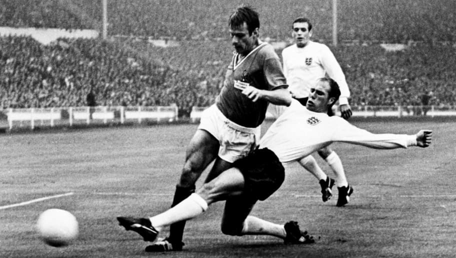 LONDRES, UNITED KINGDOM - JULY 20:  English defender Ray Wilson (R) kicks the ball away from French forward Philippe Gondet 20 July 1966 at Wembley stadium in London during the World Cup first round match between England and France. England beat France 2-0.  (Photo credit should read STAFF/AFP/Getty Images)
