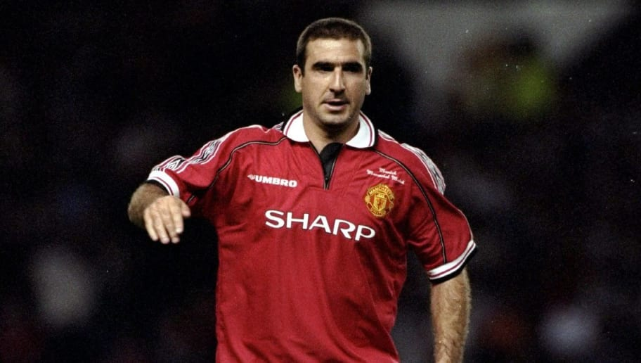 18 Aug 1998:  Eric Cantona is back in a Manchester United shirt during the Munich Testimonial match between Manchester United and the Cantona European XI at Old Trafford in Manchester, England.  \ Mandatory Credit: Clive  Brunskill/Allsport
