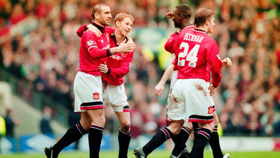 MANCHESTER, UNITED KINGDOM - APRIL 08: Manchester United goalscorer Eric Cantona (l) celebrates the winning goal with Nicky Butt, Andy Cole and David Beckham (r) during the FA Premier League match between Manchester United and Coventry City at Old Trafford on April 8, 1996 in Manchester, England.  (Photo by Shaun Botterill/Allsport/Getty Images)