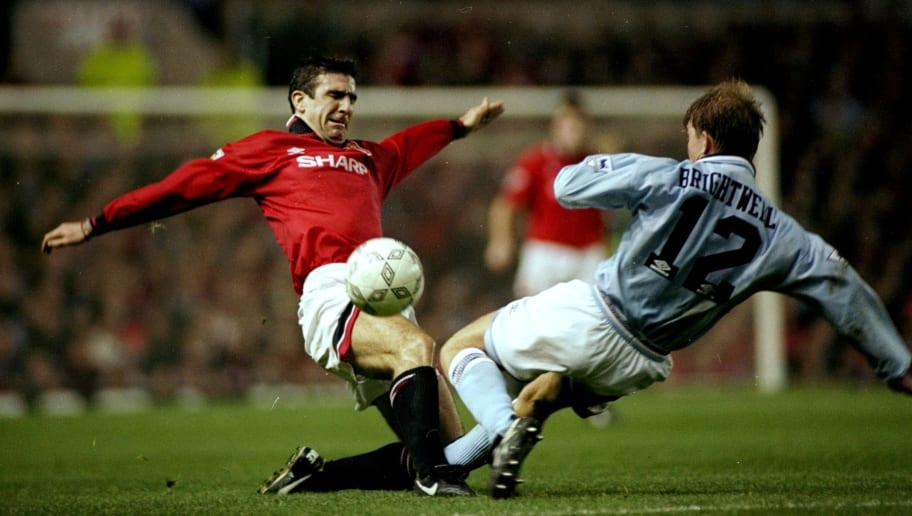 Eric Cantona of Manchester United and Ian Brightwell of Manchester City