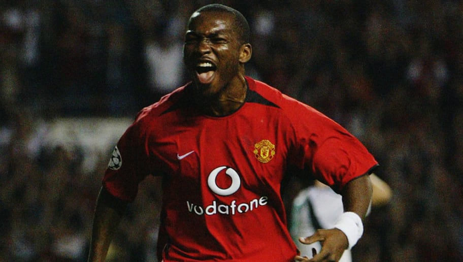MANCHESTER - SEPTEMBER 16:  Eric Djemba Djemba of Manchester United celebrates scoring during the UEFA Champions League Group E match between Manchester United and Panathinaikos on September 16, 2003 at Old Trafford in Manchester, England.  Manchester United won the match 5-0.  (Photo by Laurence Griffiths/Getty Images)