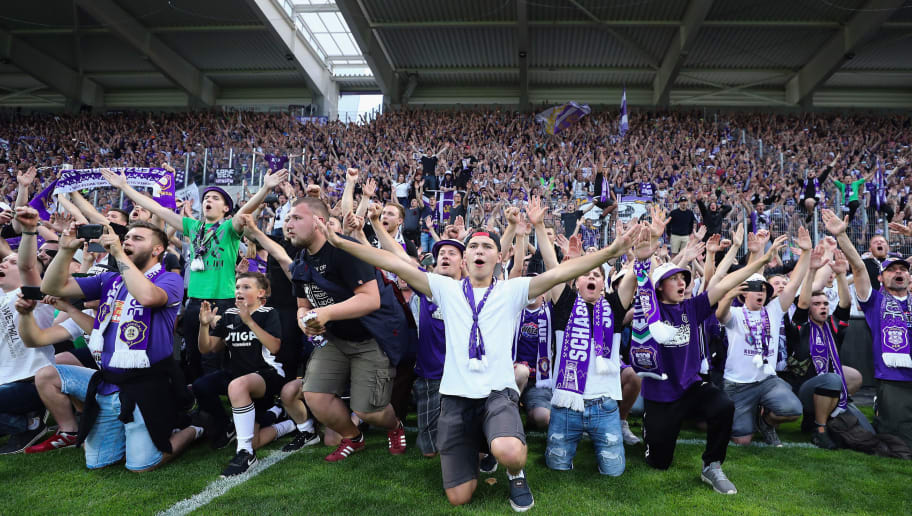 AUE, GERMANY - MAY 22:  Fans of Aue celebrate after their team won the 2. Bundesliga Playoff Leg 2 match between Erzgebirge Aue and Karlsruher SC at Sparkassen-Erzgebirgsstadion on May 22, 2018 in Aue, Germany.  (Photo by Alex Grimm/Bongarts/Getty Images)