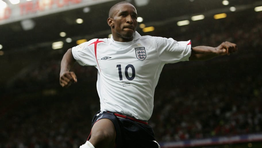 MANCHESTER, UNITED KINGDOM - SEPTEMBER 2: Jermain Defoe of England celebrates scoring his team's third goal during the Euro 2008 Qualifying match between England and Andorra at Old Trafford on September 2, 2006 in Manchester, England. (Photo by Phil Cole/Getty Images)