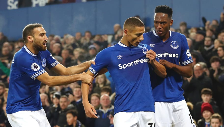 LIVERPOOL, ENGLAND - DECEMBER 05:  Richarlison of Everton celebrates with team mates Yerry Mina and Cenk Tosun after scoring their team's first goal during the Premier League match between Everton FC and Newcastle United at Goodison Park on December 5, 2018 in Liverpool, United Kingdom.  (Photo by Matthew Lewis/Getty Images)