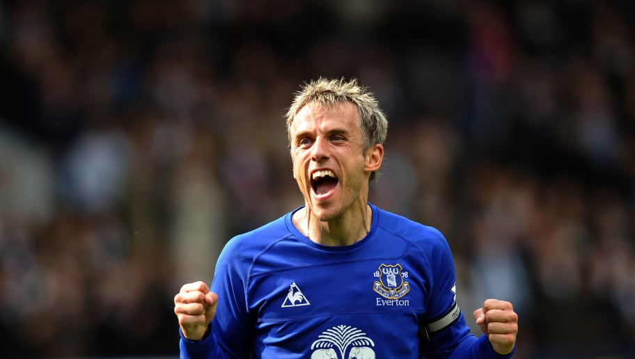 Everton's English midfielder Phil Neville celebrates their 2-1 victory in the English Premier League football match between Everton and Manchester City at Goodison Park in Liverpool, north-west England on May 7, 2011. AFP PHOTO/PAUL ELLISFOR EDITORIAL USE ONLY Additional licence required for any commercial/promotional use or use on TV or internet (except identical online version of newspaper) of Premier League/Football League photos. Tel DataCo +44 207 2981656. Do not alter/modify photo. (Photo credit should read PAUL ELLIS/AFP/Getty Images)