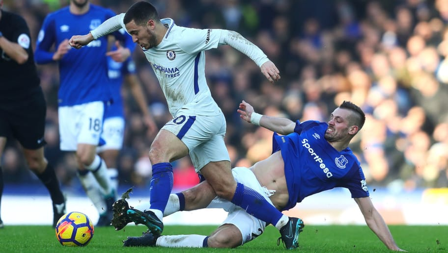 LIVERPOOL, ENGLAND - DECEMBER 23: Morgan Schneiderlin of Everton tackles Eden Hazard of Chelsea during the Premier League match between Everton and Chelsea at Goodison Park on December 23, 2017 in Liverpool, England. (Photo by Chris Brunskill Ltd/Getty Images)