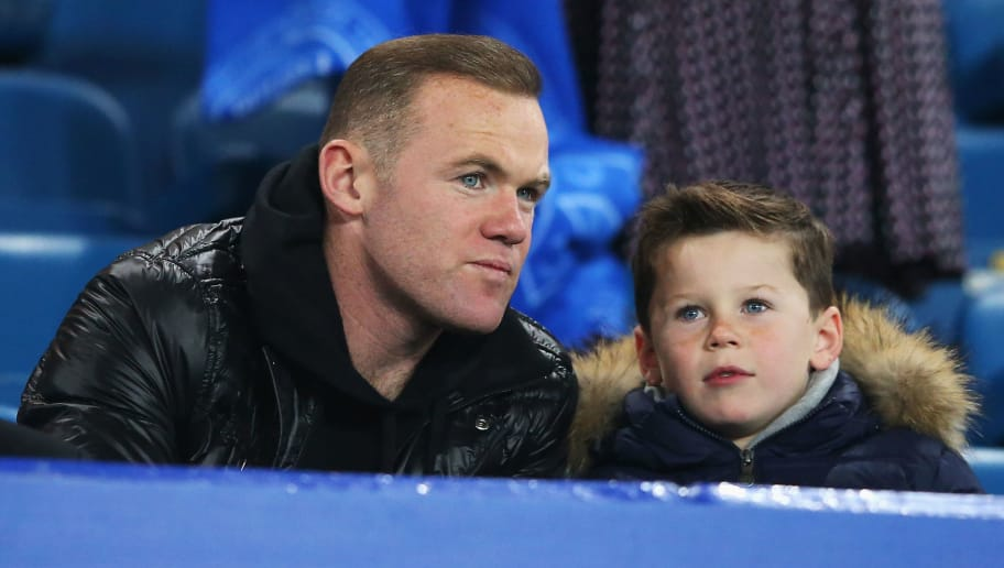 LIVERPOOL, ENGLAND - DECEMBER 07:  Wayne Rooney of Manchester United and son Kai attend the Barclays Premier League match between Everton and Crystal Palace at Goodison Park on December 7, 2015 in Liverpool, England.  (Photo by Alex Livesey/Getty Images)