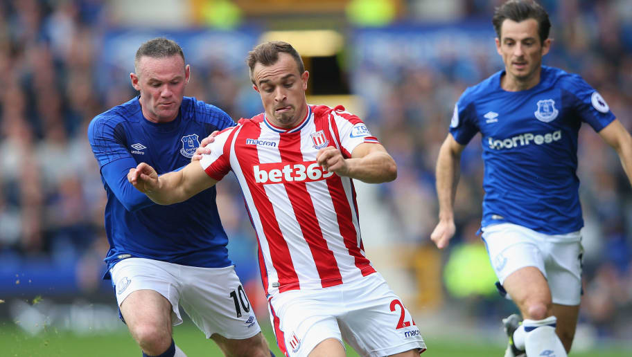 LIVERPOOL, ENGLAND - AUGUST 12:  Xherdn Shaqiri of Stoke City  attempts to get away from Wayne Rooney of Everton during the Premier League match between Everton and Stoke City at Goodison Park on August 12, 2017 in Liverpool, England.  (Photo by Alex Livesey/Getty Images)