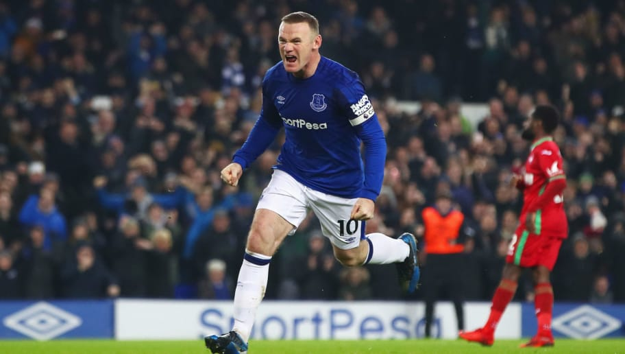 LIVERPOOL, ENGLAND - DECEMBER 18:  Wayne Rooney of Everton celebrates as he scores their third goal from the penalty spot during the Premier League match between Everton and Swansea City at Goodison Park on December 18, 2017 in Liverpool, England.  (Photo by Clive Brunskill/Getty Images)