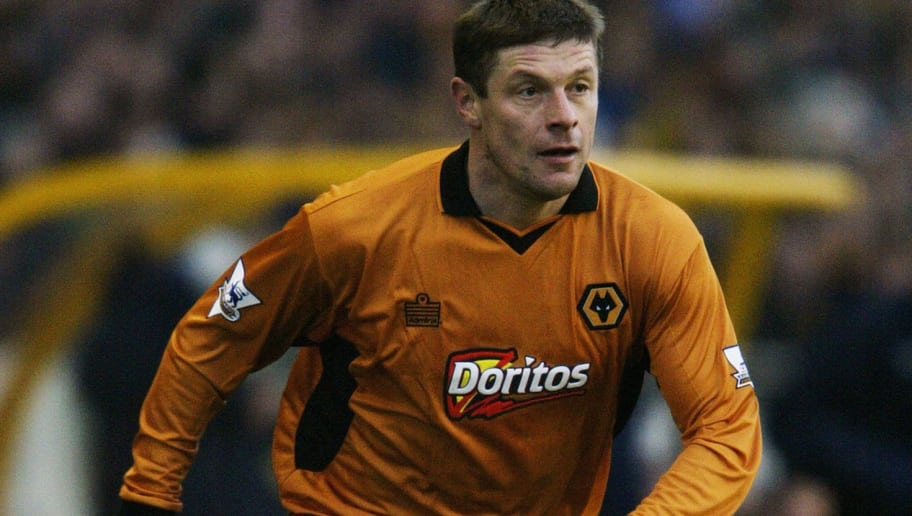 WOLVERHAMPTON - DECEMBER 28:  Oleg Luzhny of Wolverhampton Wanderers runs with the ball during the FA Barclaycard Premiership match between Wolverhampton Wanderers and Leeds United held on December 28, 2003 at Molineux, in Wolverhampton, England. Wolverhampton Wanderers won the match 3-1. (Photo by Jamie McDonald/Getty Images)
