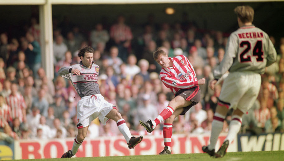 SOUTHAMPTON - APRIL 13:  Matthew Le Tissier of Southampton shoots at goal as Ryan Giggs of Manchester United makes a challenge during the FA Carling Premiership match between Southampton and Manchester United held on April 13, 1996 at The Dell, in Southampton, England. Southampton won the match 3-1. (Photo by Shaun Botterill/Getty Images)