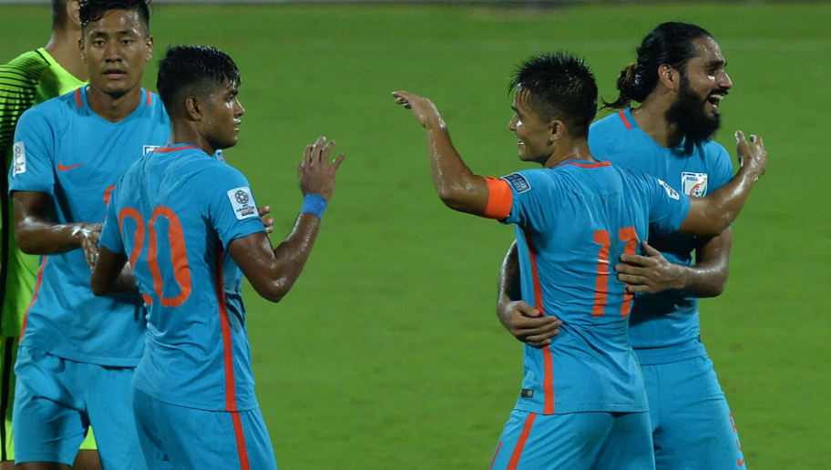 Indian football team captain Sunil Chhetri (2R) celebrates his team's 4-1 victory during the 2019 AFC?Asian Cup qualifying match between India and Macau held at the Kanteerava Stadium in Bangalore on October 11, 2017. / AFP PHOTO / Manjunath KIRAN        (Photo credit should read MANJUNATH KIRAN/AFP/Getty Images)