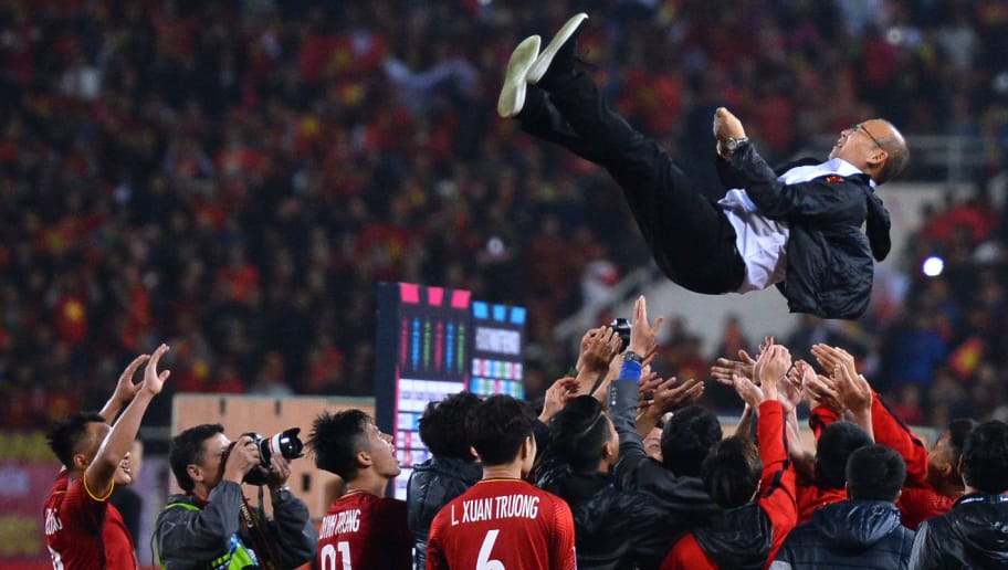 Vietnam's players celebrate with coach Park Hang-seo after winning the AFF Suzuki Cup 2018 championship following the AFF Suzuki Cup 2018 final football match between Vietnam and Malaysia at the My Dinh Stadium in Hanoi on December 15, 2018. (Photo by Nhac NGUYEN / AFP)        (Photo credit should read NHAC NGUYEN/AFP/Getty Images)