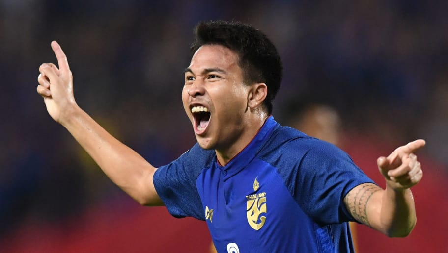 Thailand's midfielder Thitipan Puangchan celebrates after scoring a goal against Malaysia during the second leg of the AFF Suzuki Cup 2018 semifinal football match between Thailand and Malaysia at the Rajamangala Stadium in Bangkok on December 5, 2018. (Photo by Lillian SUWANRUMPHA / AFP)        (Photo credit should read LILLIAN SUWANRUMPHA/AFP/Getty Images)